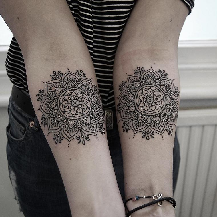 tatuaggio-avambraccio-due-disegni-tondeggianti