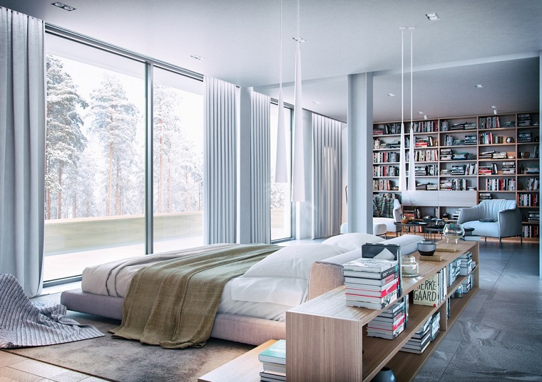 ampia-camera-da-letto-mobili-legno-libreria-parete-zona-relax-grande-finestra
