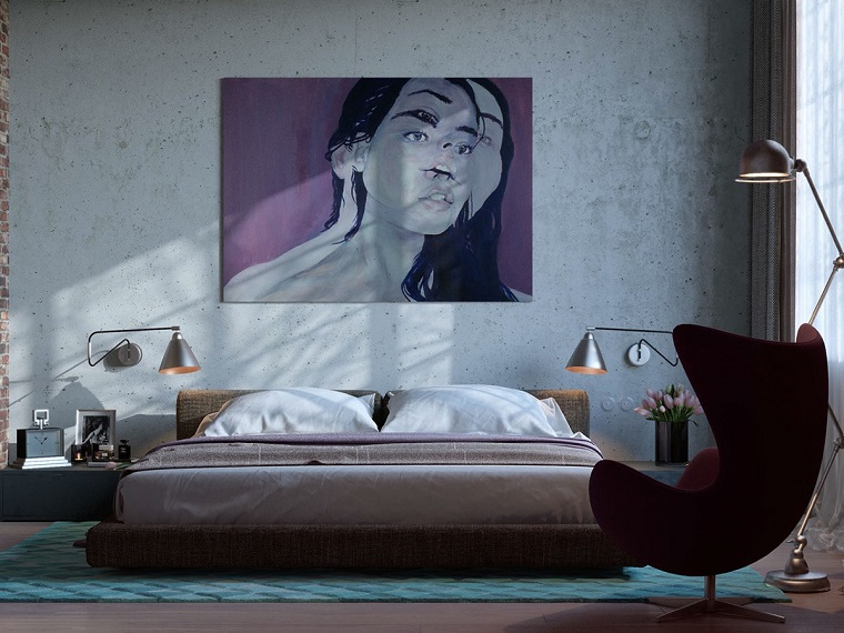 come-arredare-la-camera-da-letto-quadro-parete-poltrona-tessuto-rosso-pavimento-legno