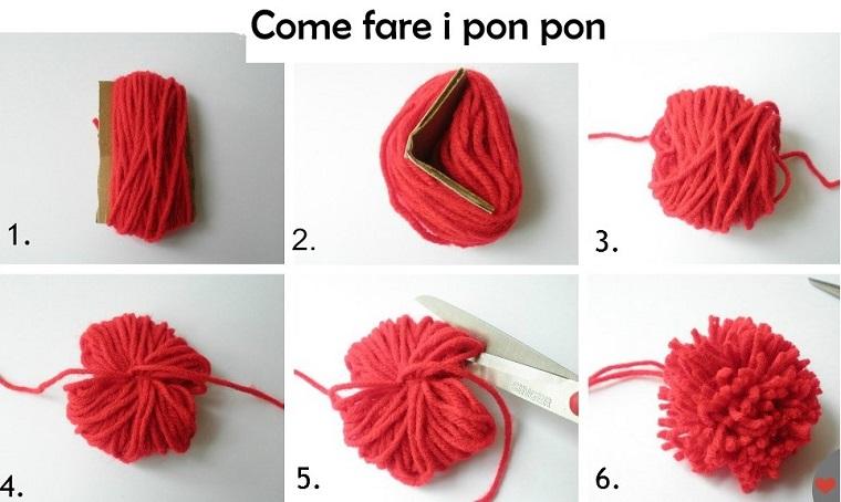 Come fare i pon pon, rotolo di lana di colore rosso legato con nastro e tagliato alle estremità