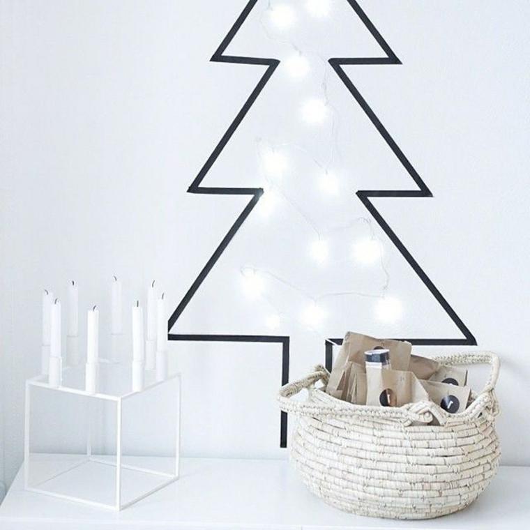 Washi tape per decorare le pareti, albero di Natale con una catena di luci e candele in un portacandele originale