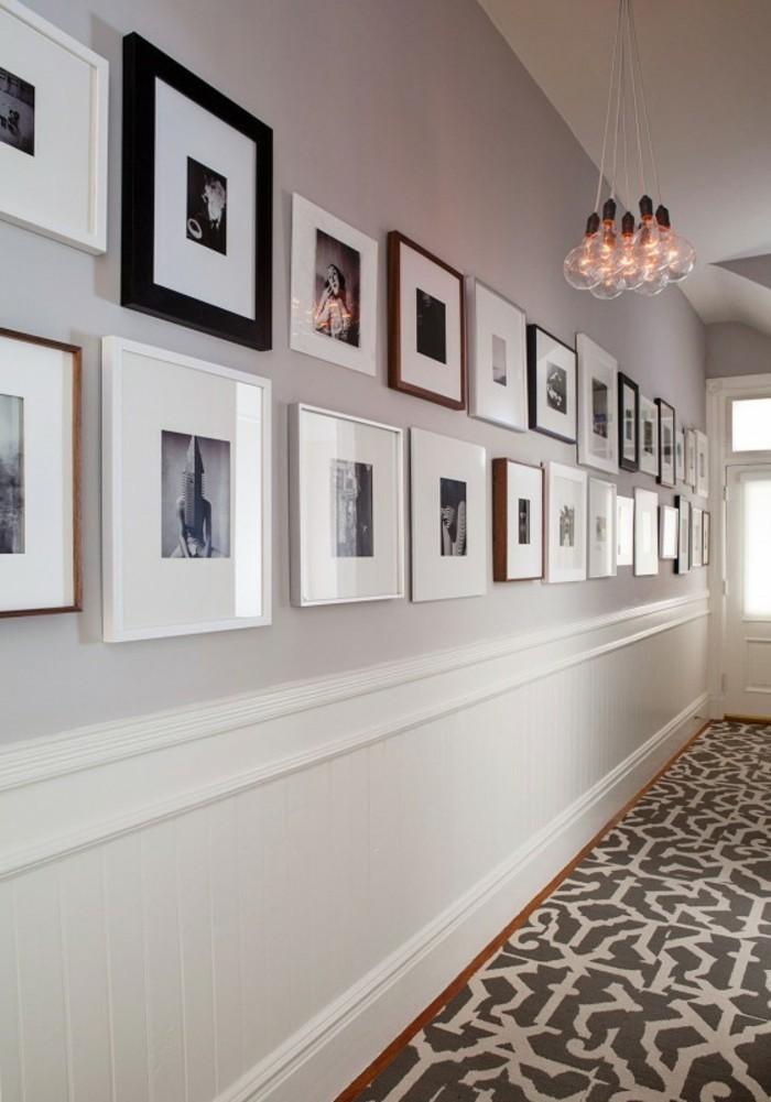 arredare-un-corridoio-design-pavimento-tappeto-colorato-pareti-quadri-cornici-foto