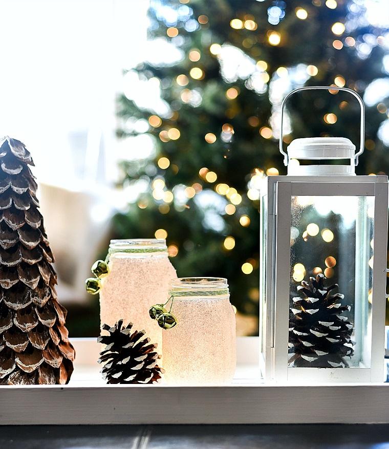 barattoli di vetro decorati con il sale centrotavola con pigne e lanterne