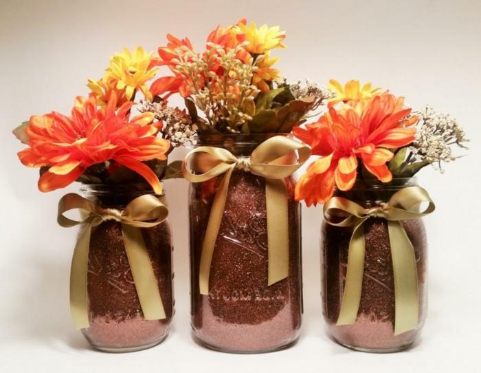 barattoli-di-vetro-decorazioni-fai-da-te-fiori-arancioni-gialli-fiocco-dorato-collo