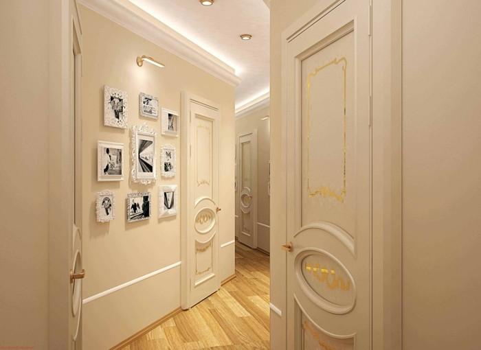 come-arredare-un-corridoio-pavimento-parquet-colore-chiaro-muro-bianco-decorazione-foto-cornici