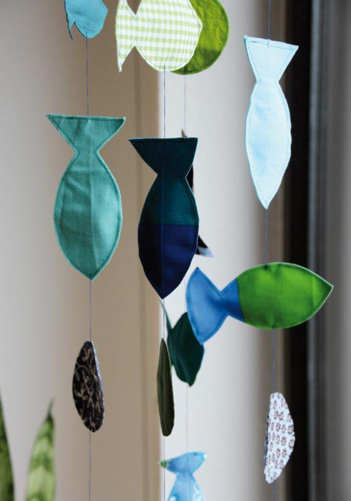 decorare-finestre-addobbi-fai-da-te-pesci-stoffa-colorati-filo-tipo-carillon