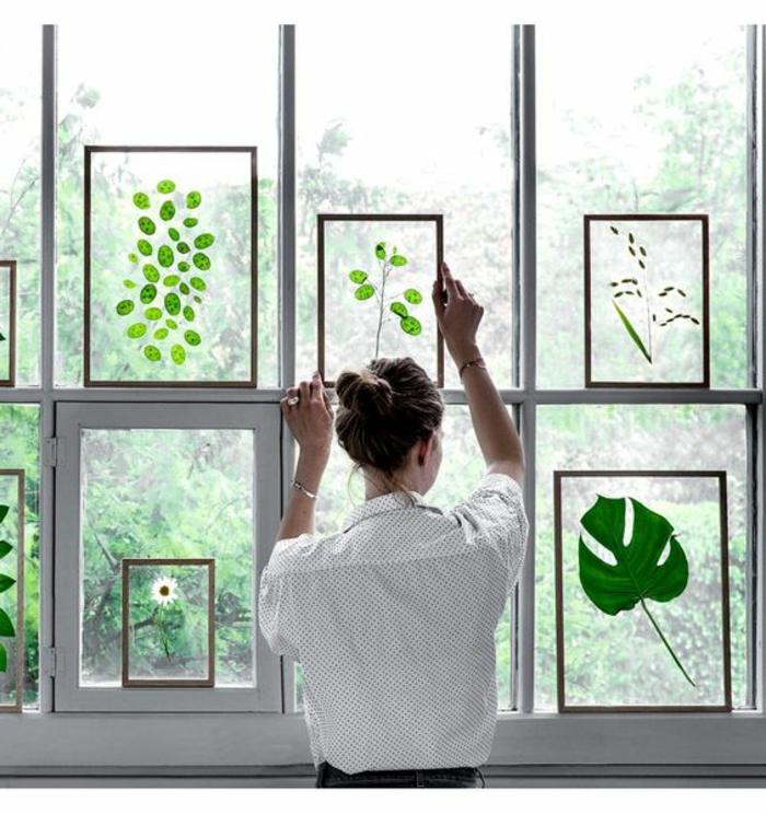 decorare-finestre-foglie-verdi-idea-fai-da-te-donna-fiori-piante