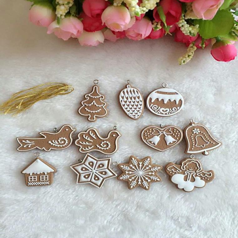 Stampi per biscotti diverse forme, decorazione con della glassa reale sui bordi