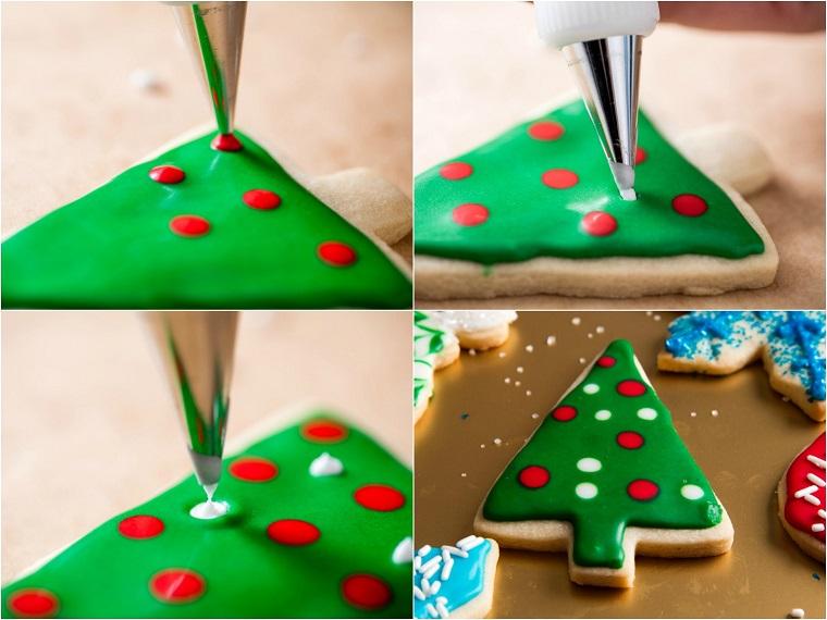 Biscotti semplici, decorati con della glassa reale di colore verde e punti rossi per gli addobbi con l'aiuto di una sac à poche