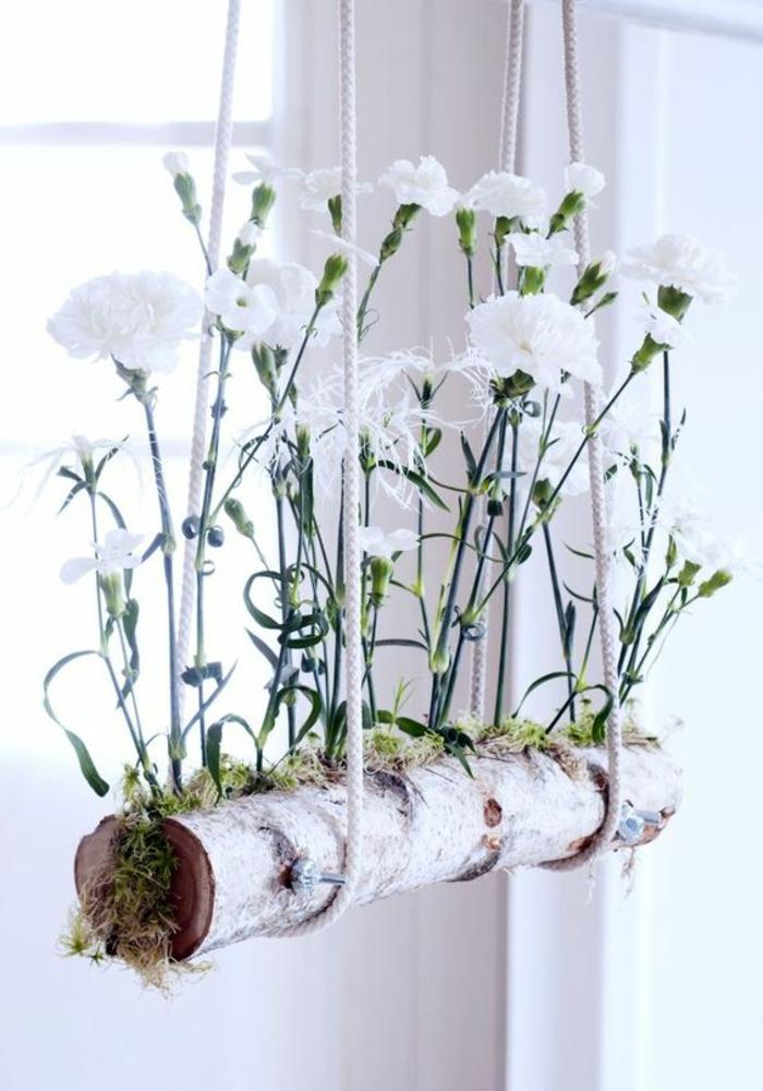 fai-da-te-casa-decorazione-finestre-ramo-albero-vaso-fiori-colore-bianco-erbetta-idea-originale