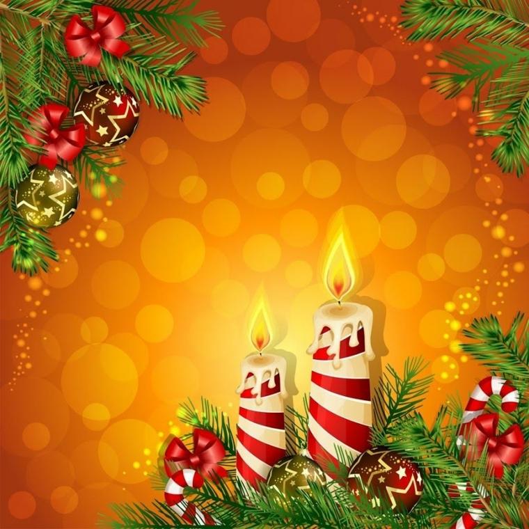 due candele a strisce bianche e rosse su sfondo arancione a palline, del vischio e dei fiocchetti