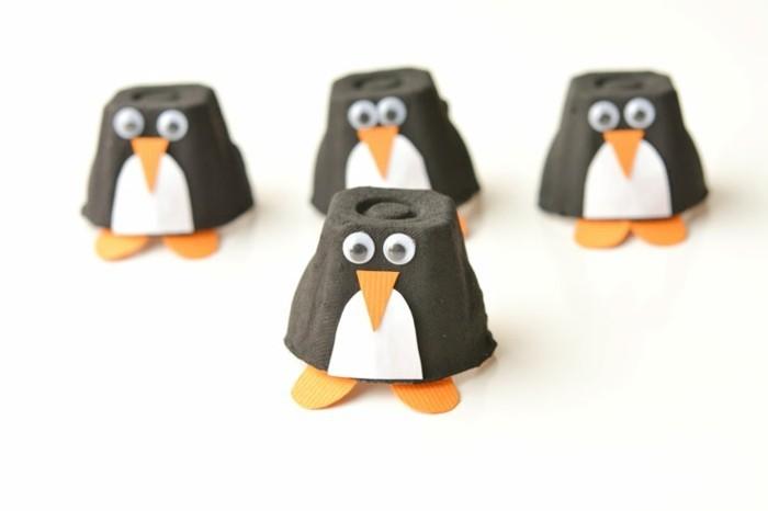 lavoretti-da-fare-con-i-bambini-pinguini-realizzati-cartone-uova-tagliati-colorati-occhi-mobili-becco-zampe