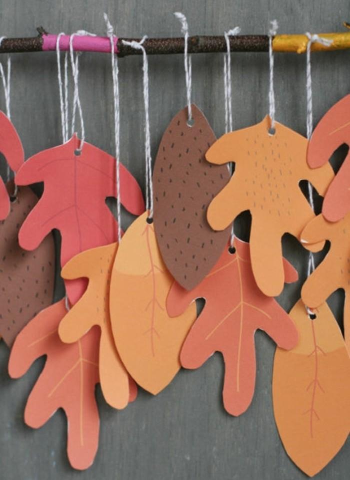 lavoretti-manuali-per-bambini-cartoncini-ritagliati-forma-foglie-appese-bastoncino-filo-bianco