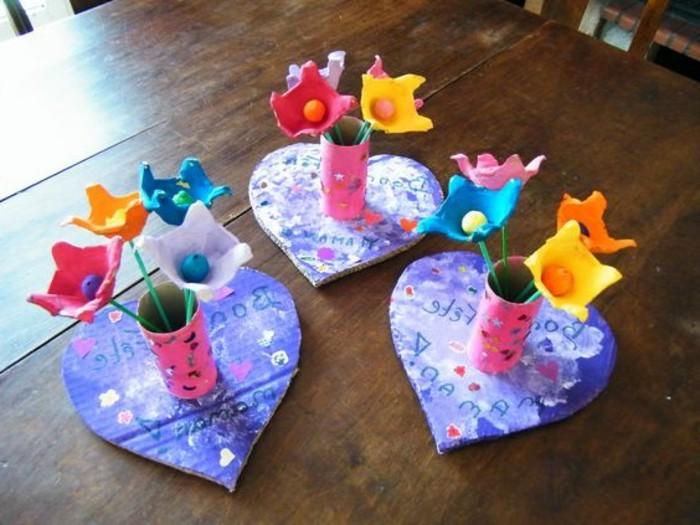 lavoretto-per-bambini-cuori-cartone-centro-vasetto-realizzato-rotolo-carta-igienica-colorato-decorato-fiori-multicolore