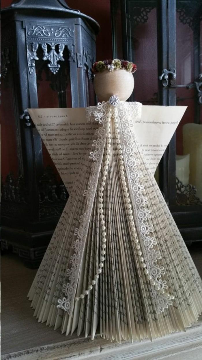 libro-piegato-forma-angelo-alcune-decorazioni-applicate-completare-scultura