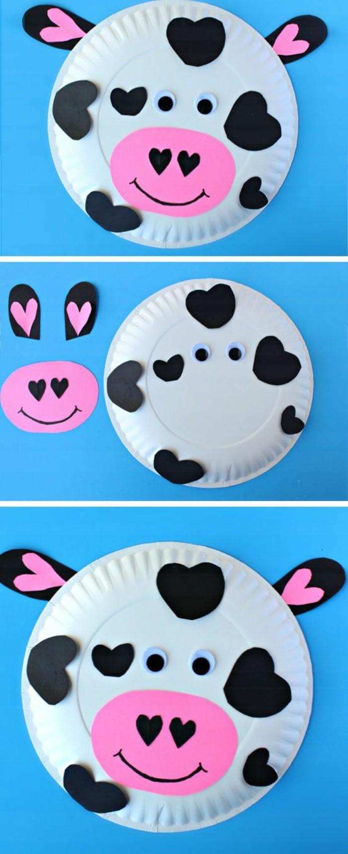 piatto-carta-trasformato-mucca-cuori-neri-incollati-orecchie-naso-rosa-occhi-mobili