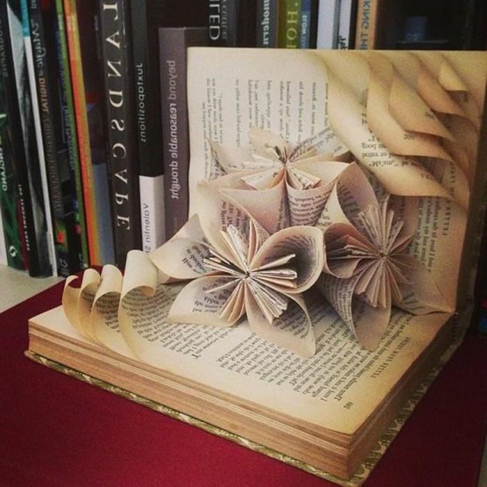 piegare-pagine-libro-usato-dare-forma-bellissimi-fiori-decorare-casa