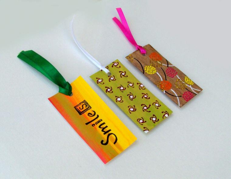 con la carta e dei nastrini è possibile dare forma a dei segnalibri: un'idea originale fai da te da regalare