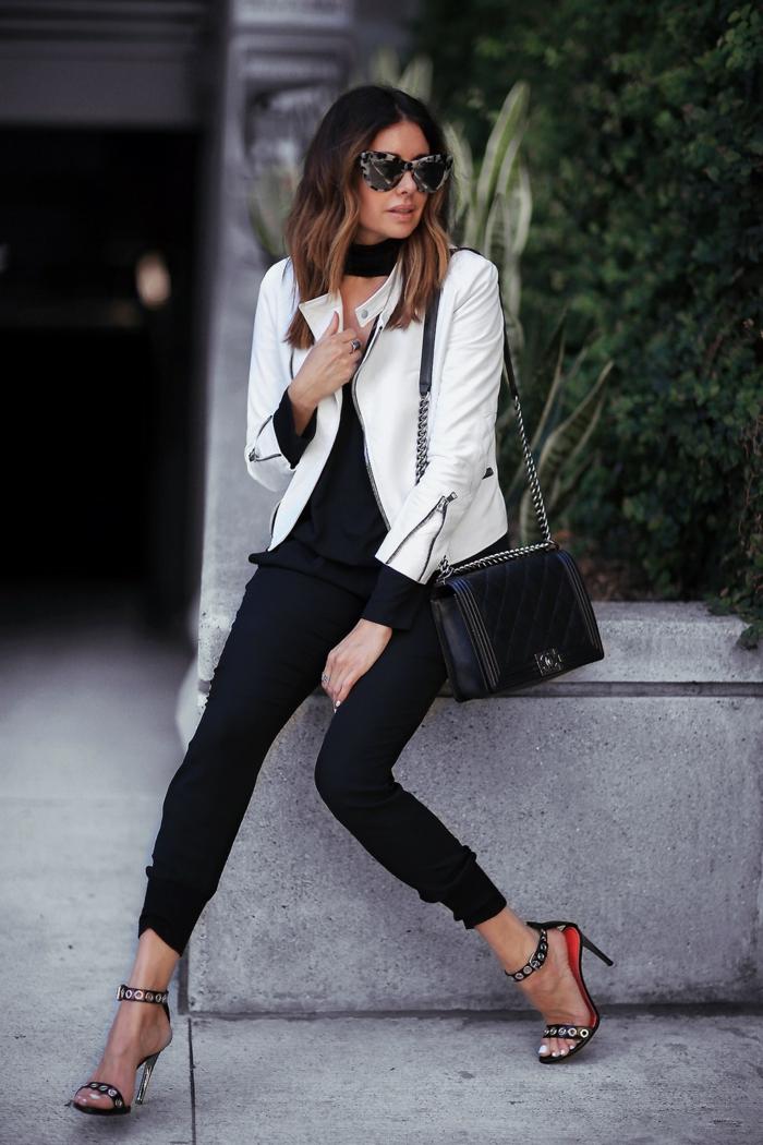 tacchi-alti-brillantini-borsa-nera-catena-pantalone-nero-giacca-pelle-bianca-capelli-caschetto-Bob-occhiali-da-sole