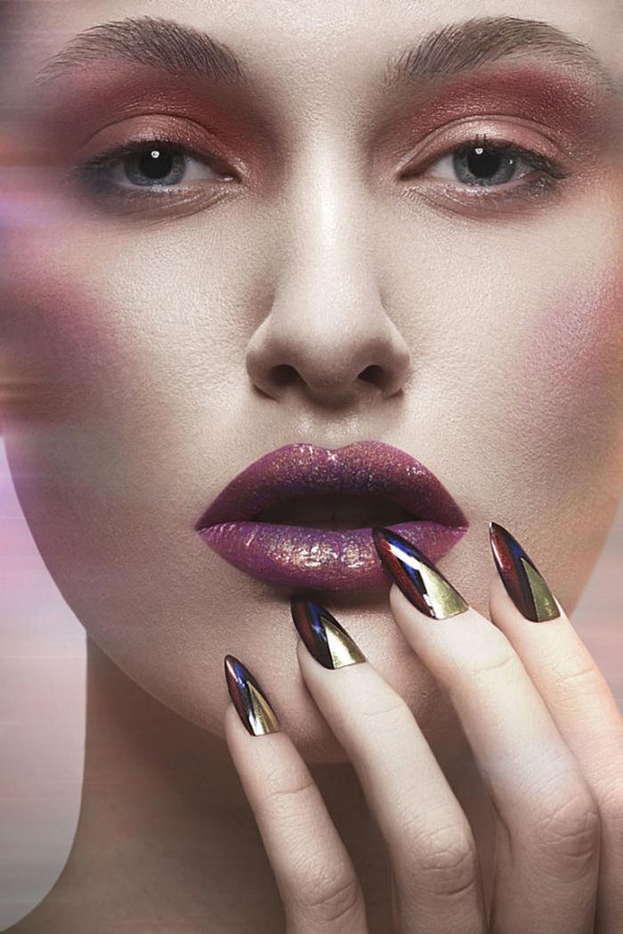 unghie-gel-a-punta-color-metallizzato-effetto-lucido-donna-viso-trucco-labbra-carnose