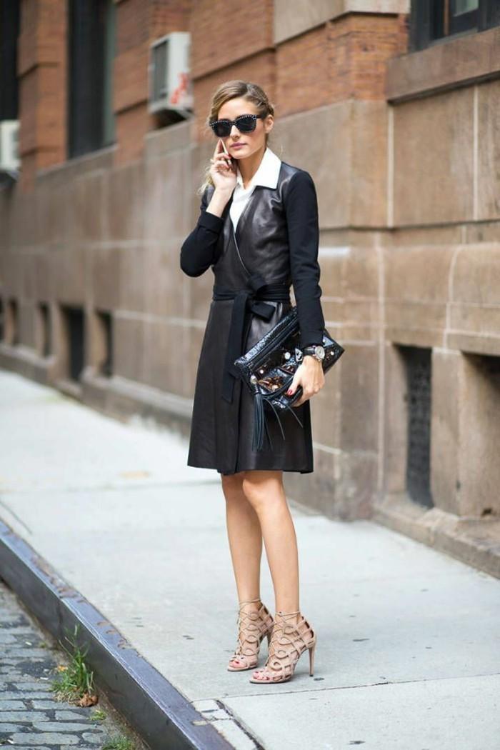 vestiti-eleganti-fashion-olivia-palermo-cappotto-lungo-nero-cintura-scarpe-tacchi-colore-beige-sandalo-camicia-bianca-borsa-mano-gonna