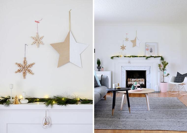 Addobbi natalizi in stile scandinavo, stelle da parete in legno e ghirlanda di rametti sul camino