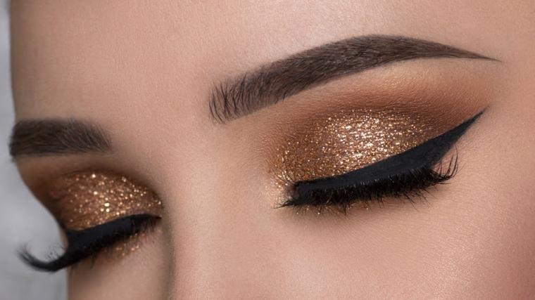 truccare gli occhi, una proposta per le occasioni particolari con eye liner e ombretto bronzo brillante