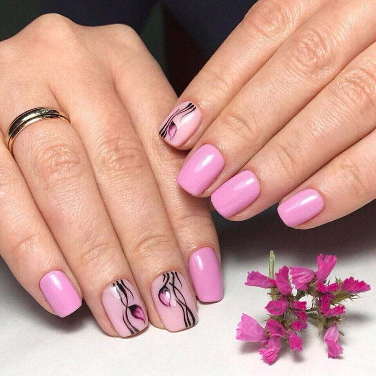 unghie primaverili, una manicure realizzata con dello smalto rosa di  diverse tonalità e delle decorazioni