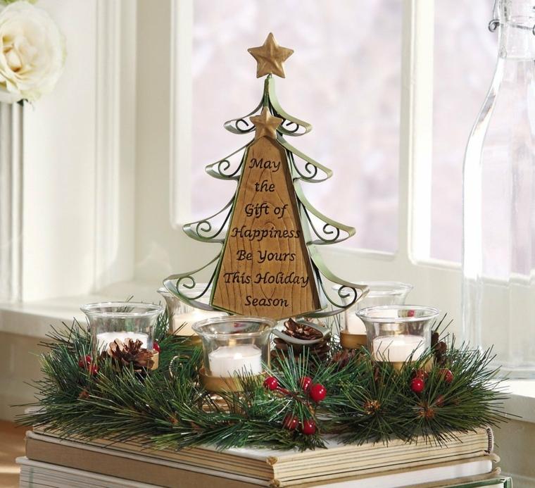Idee per Natale, un centrotavola con un albero di natale in legno, rametti verdi e bacche rosse