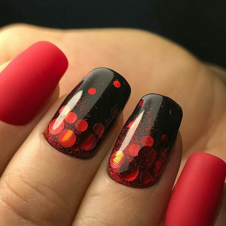 unghie rosso, una manicure spettacolare che gioca sul contrasto tra i accesi del rosso e il nero