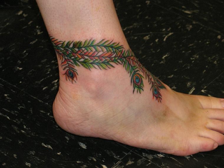 tatuaggio sulla caviglia, un'idea unisex con dei rami e delle foglie che terminano in occhi
