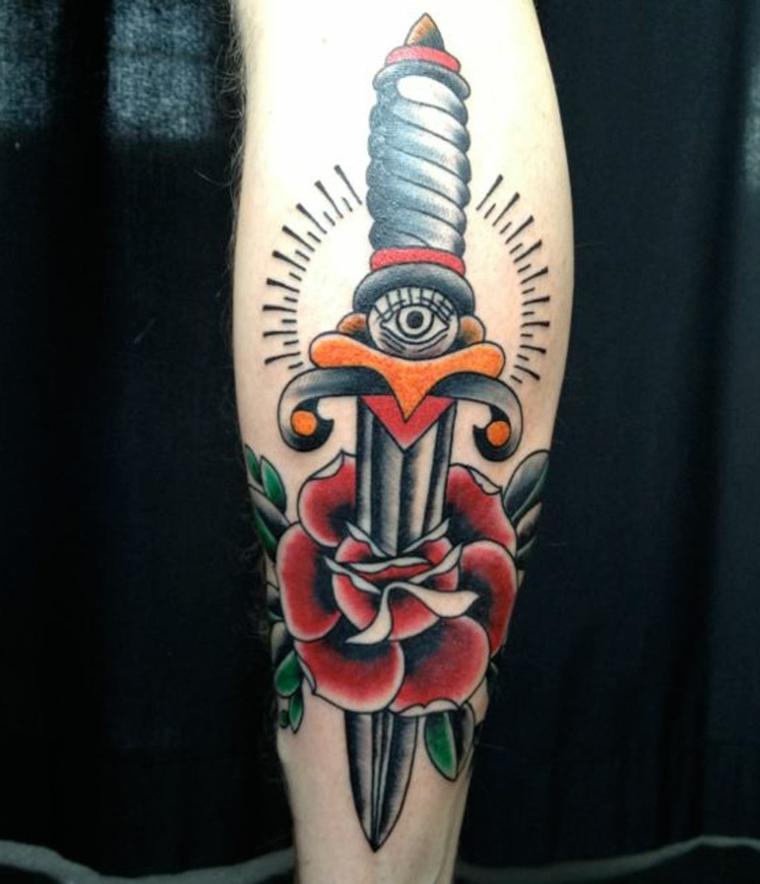 tatuaggi old style, proposta originale con un pugnale che trafigge una rosa, con un occhi sotto l'impugnatura