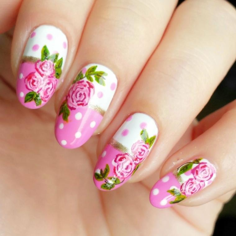 nail art design dedicata alla primavera con smalto e rose rose, smalto bianco e foglie verdi