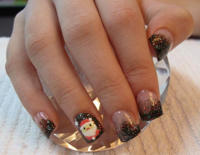 nail art natalizie, un'idea con dello smalto nero glitterato da metà unghia e un grazioso babbo natale