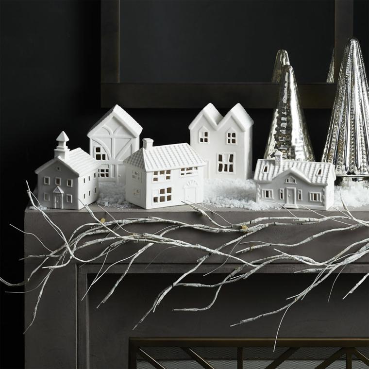 Decorazioni di Natale, casette di colore bianco e alberi natalizi in metallo dal design moderno