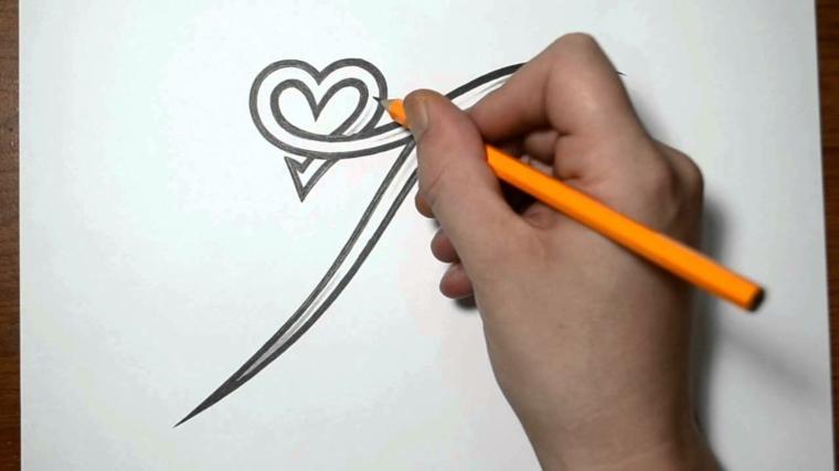 fasi finale della realizzazione di un disegno per tatuaggi cuori piccoli particolare