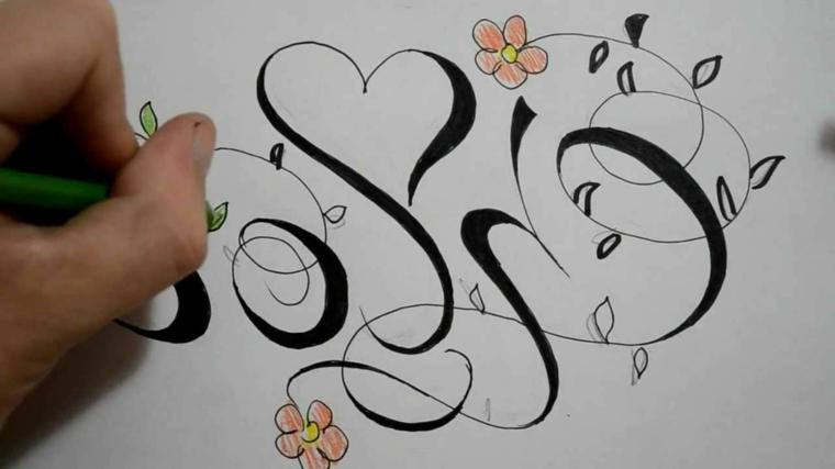 fasi finale della realizzazione di un disegno per tatuaggio a cuore con delle altre decorazioni