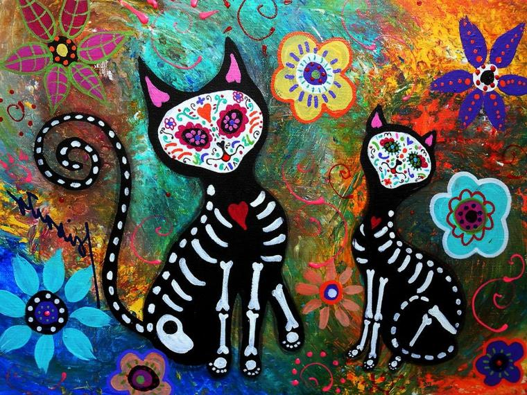 un'immagine con due gatti con teschio messicano e scheletro e sfondo colorato
