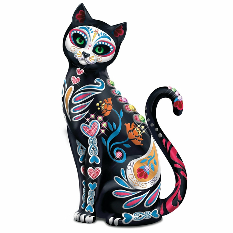 un gatto con il teschio della tradizione messicana e una serie di altri simboli