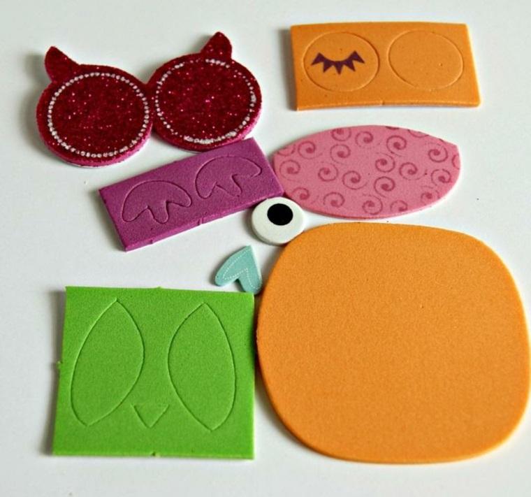 Oggetti fai da te e un'idea per la realizzazione di un gufetto di carta gomma di diverso colore