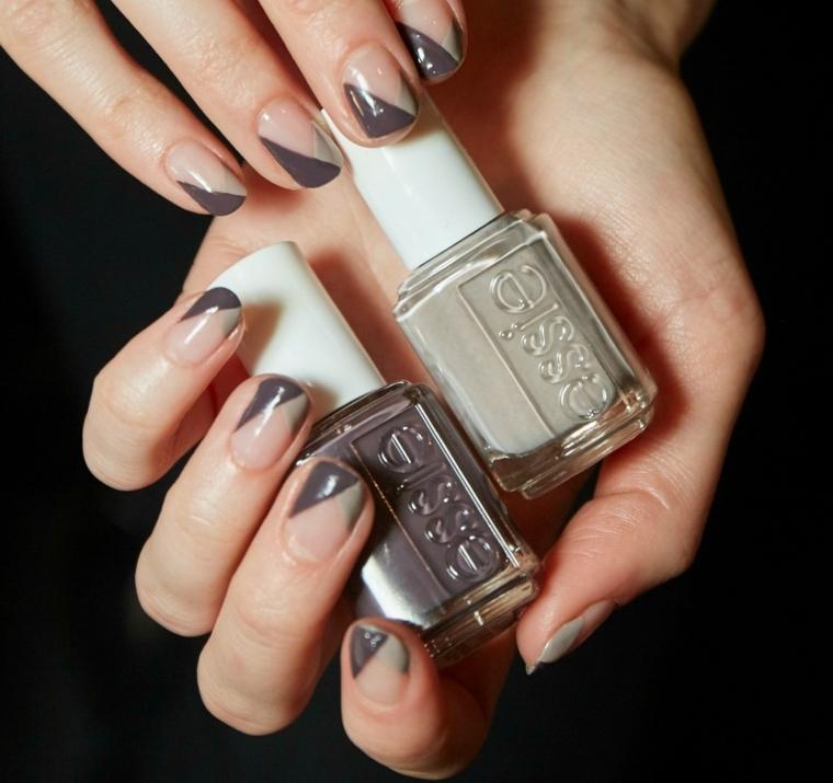 Unghie dipinte per metà di grigio chiaro e scuro, forma a mandorla elegante