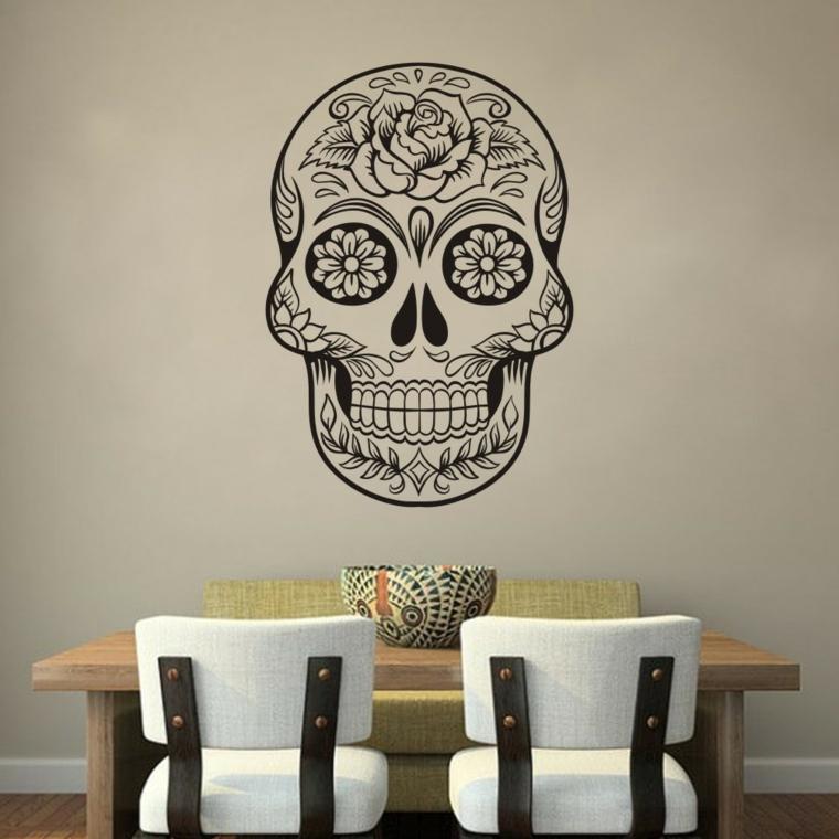 idea per decorare un muro bianco con uno sticker raffigurante un teschio della tradizione messicana