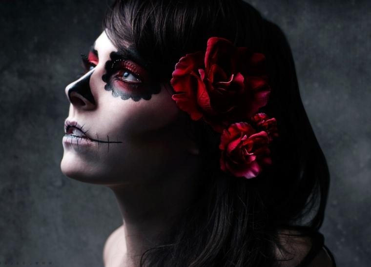 immagini teschi messicani, il profilo di una donna con il volto truccato con il rosso e il nero