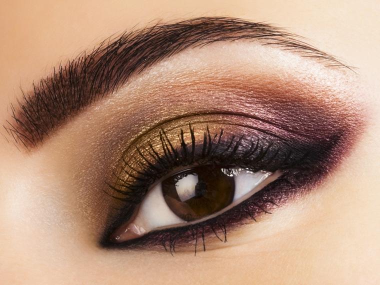 come truccare gli occhi marroni utilizzando degli ombretti dalle sfumature calde e perlate