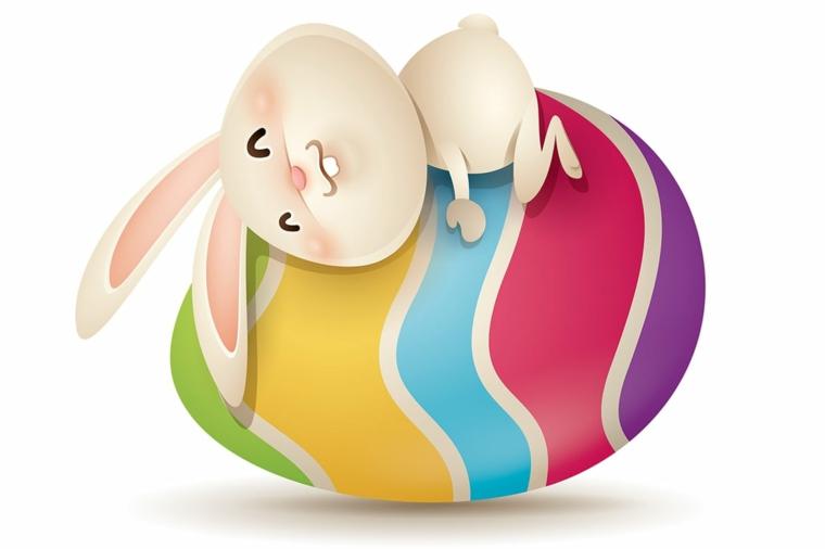 una proposta per immagini uova di pasqua con un coniglio abbracciato ad un uovo colorato