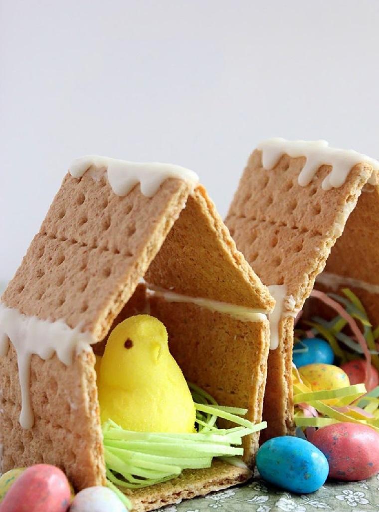 Lavoretti di pasqua, casette per i pulcini con dei cracker e glassa bianca