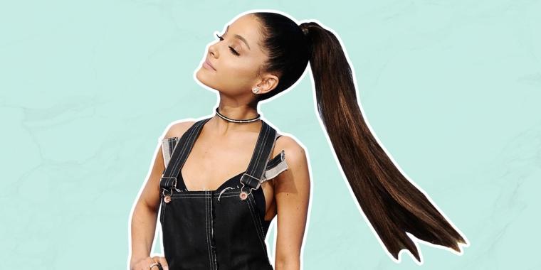 una ragazza con delle acconciature raccolte a coda di cavallo, capelli lunghi e lisci