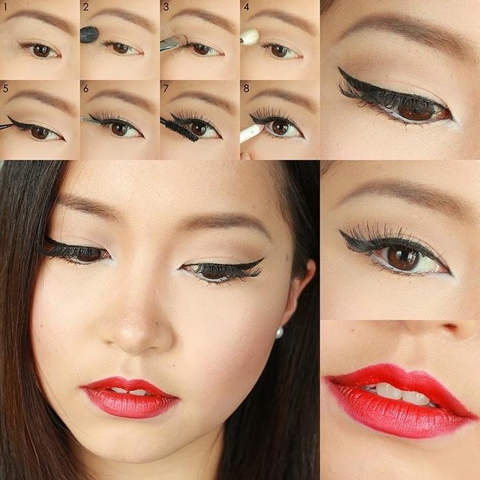 un makeup rossetto rosso, dell'eye liner nero con la matita bianca all'interno dell'occhio