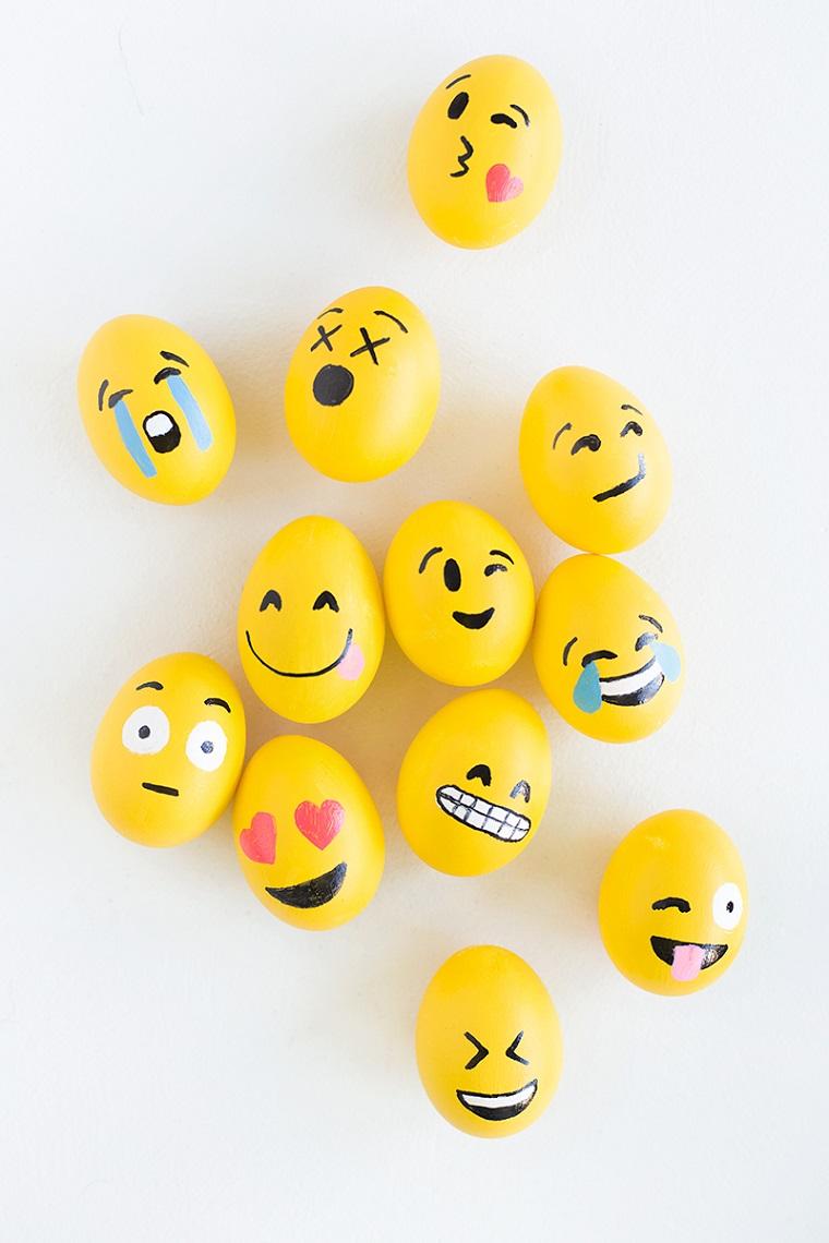 Uova gialle con faccine emoji, lavori per pasqua fai da te, disegni facili da fare