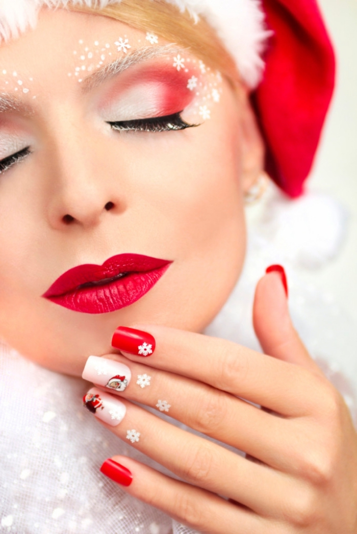un trucco per le feste di natale con del rossetto e dell'ombretto rossi, unghie decorate